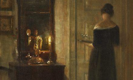 """""""Interior con una mujer a la luz de las velas"""" (1900), de Carl Holsøe"""